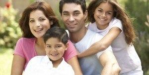 hispanic_family_enjoying_day_in_park-300×152